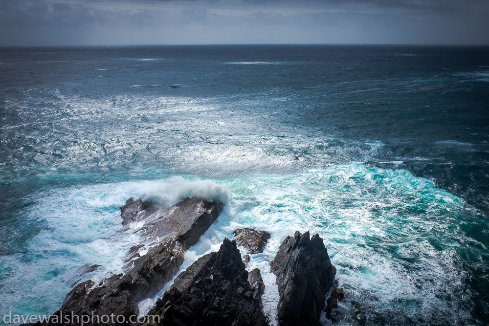 Waves breaking on rocks, Mizen Head, Cork, Ireland